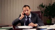 stock-footage-angry-boss-with-cellphone-and-documents-in-the-office-camera-stabilizer-shot